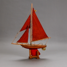 Photo of antique English Pond Boat With Red Sails and Rudder