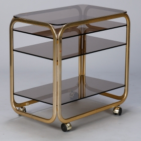 Photo of antique Mid Century Brass Plated Bar or Serving Cart with Smoked Glass