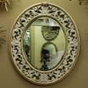 Italian Oval White Framed Mirror With Reticulated Design Over Velvet