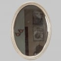 Pair of Silver Leaf Framed Oval Mirrors