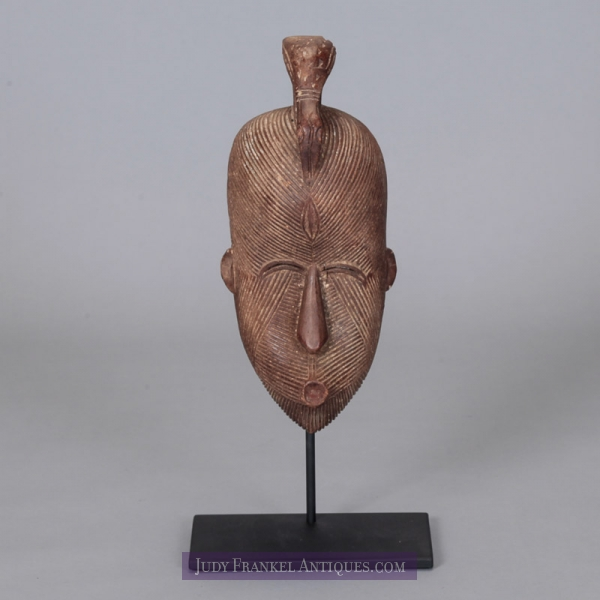 Photo of Carved Wood Nigerian Mask with Bird